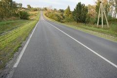 Carretera de asfalto de tierra del camino Fotografía de archivo libre de regalías