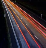 Carretera en la noche fotografía de archivo