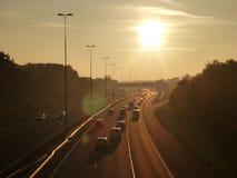 Carretera en la puesta del sol Fotos de archivo libres de regalías