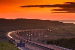 Carretera en la puesta del sol Fotos de archivo