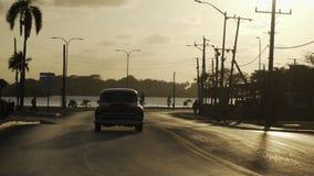 Carretera en la puesta del sol almacen de metraje de vídeo
