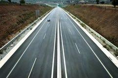 Carretera larga y recta Fotografía de archivo libre de regalías