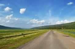 Carretera nacional con el cielo Imagen de archivo libre de regalías