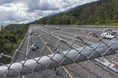 Carretera nacional con la cerca Imágenes de archivo libres de regalías