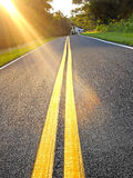 Carretera nacional en la puesta del sol Fotos de archivo libres de regalías