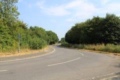 Carretera nacional vacía de enrrollamiento en Essex rural fotografía de archivo