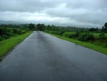 Carretera vacía de la aldea Foto de archivo