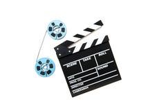 Carretes de la película del vintage 8m m y fondo azules del blanco del tablero de chapaleta Imagen de archivo libre de regalías