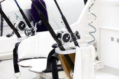 Carretes de la pesca y barras del poste Imagen de archivo libre de regalías
