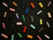 Carretes de mentira de diferente coloreados Imagen de archivo libre de regalías
