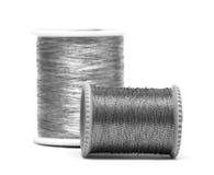 Carretes de plata de cuerdas de rosca fotografía de archivo libre de regalías