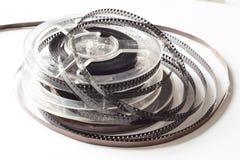 Carretes viejos con la película blanco y negro y la cinta magnética Imagen de archivo libre de regalías