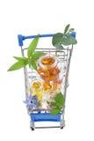 Carretilla azul de las compras con las píldoras y la medicina Imágenes de archivo libres de regalías