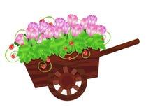 Carretilla con las flores Fotografía de archivo