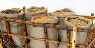 Carretilla con los granos en sacos Imagen de archivo libre de regalías