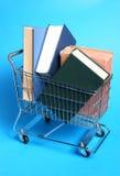 Carretilla con los libros Fotografía de archivo