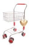 Carretilla de las compras con el corazón Foto de archivo libre de regalías