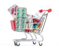 Carretilla de las compras con las píldoras y la medicina Imágenes de archivo libres de regalías