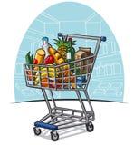 Carretilla de las compras con los productos Imagenes de archivo