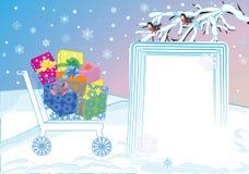 Carretilla de las compras con los regalos Imagenes de archivo
