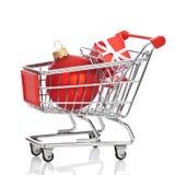 Carretilla de las compras de la Navidad Imagen de archivo