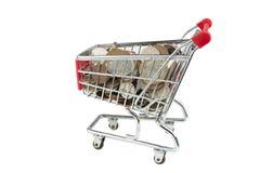 Carretilla de las compras por completo del dinero Foto de archivo libre de regalías