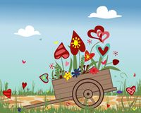 Carretilla de mano con los corazones florecientes en fondo del cielo Imagenes de archivo