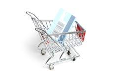 Carretilla miniatura de las compras Imagen de archivo