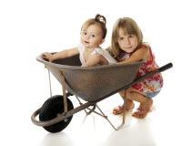 Carretilla por completo del bebé Imagen de archivo libre de regalías