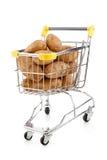 Carretilla y patatas de las compras Fotografía de archivo libre de regalías