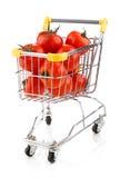 Carretilla y tomates de las compras Imagen de archivo libre de regalías