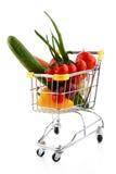 Carretilla y verduras de las compras Fotografía de archivo