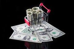 Carretto con soldi Immagini Stock