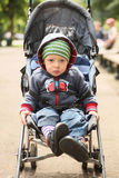In carriage. Portrait of cute little boy sitting in carriage Stock Image