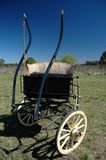 Carriage in blue. Old wooden carriage in the countryside Stock Photos
