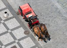 Carriage with a coachman on the Old Town Square Royalty Free Stock Image