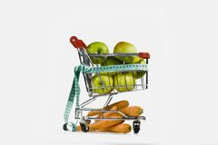 The carriage and diet. Composition from dietary products and carriages from a supermarket Stock Photo