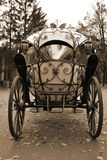 Carriage From Fairy Tale. Fairy tale forged coach with big metal wheels, beautiful decor and mirror glass windows Stock Image