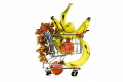 The carriage and grapes. Composition from grapes, a banana, a pomegranate and carriages from a supermarket Stock Photography