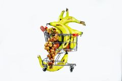 The carriage and grapes-2. Composition from yellow a banana and grapes in the carriage from a supermarket Stock Image