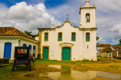 Carriage an, horse in front of a old church. PARATY, RIO DE JANEIRO, BRAZIL - JAN 17, 2016: Carriage an, horse in front of a old church. Paraty is a colonial Royalty Free Stock Photos