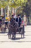 Carriage horses at the fair. In Rota in Cadiz Spain, seen some people walking. is an editorial image vertical on a sunny day Royalty Free Stock Image