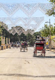 Carriage horses at the fair. In Rota in Cadiz Spain, seen some people walking. is an editorial image vertical on a sunny day Royalty Free Stock Photography