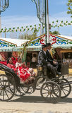 Carriage horses at the fair. In Rota in Cadiz Spain, seen some people walking. is an editorial image vertically on a sunny day Stock Images
