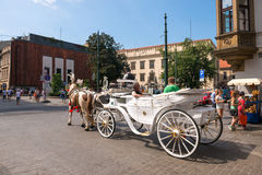 Carriage and horses in Krakow,Poland . Unidentified people. Royalty Free Stock Images