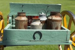 Carriage with old and rusty milk cans Royalty Free Stock Photo