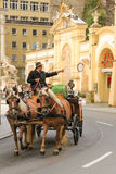 Carriage passing by the pferdeschwemme. Salzburg. Austria Stock Photography