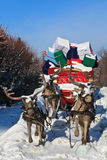 Carriage with reindeer. A carriage pulled by four reindeer with gifts Stock Images