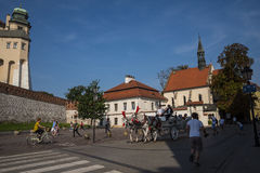 Carriage ride past the Royal Wawel Castle in Krakow Poland Stock Images