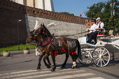Carriage ride past thethe Royal Wawel Castle in Krakow Poland Royalty Free Stock Images
